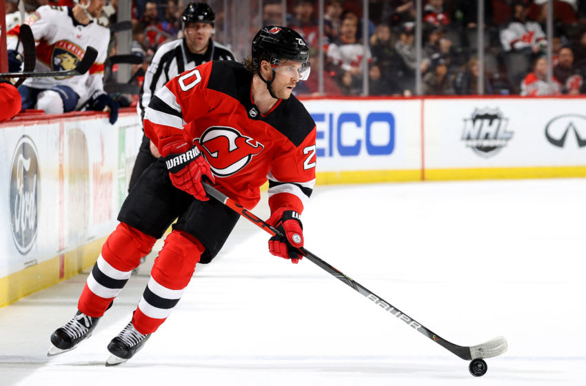 NEWARK, NEW JERSEY - FEBRUARY 11: Blake Coleman #20 of the New Jersey Devils takes the puck in the second period against the Florida Panthers at Prudential Center on February 11, 2020 in Newark, New Jersey. (Photo by Elsa/Getty Images)