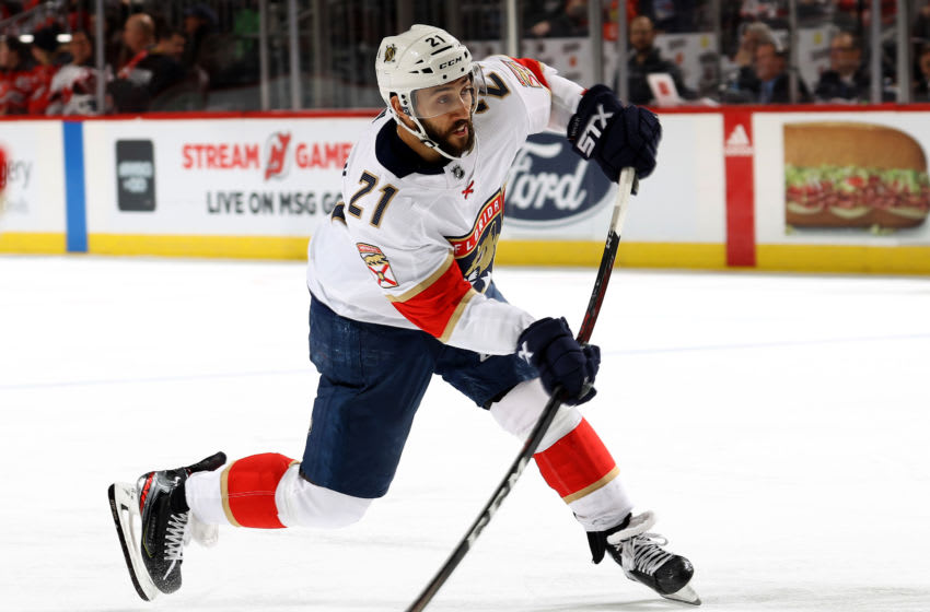 NEWARK, NEW JERSEY - FEBRUARY 11: Vincent Trocheck #21 of the Florida Panthers takes a shot in the third period against the New Jersey Devils at Prudential Center on February 11, 2020 in Newark, New Jersey.The Florida Panthers defeated the New Jersey Devils 5-3. (Photo by Elsa/Getty Images)