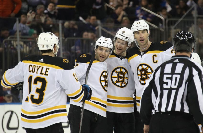 NEW YORK, NEW YORK - FEBRUARY 16: The Boston Bruins celebrate an empty net goal by Patrice Bergeron #37 (2nd from left) against the New York Rangers at Madison Square Garden on February 16, 2020 in New York City. The Bruins defeated the Rangers 3-1. (Photo by Bruce Bennett/Getty Images)