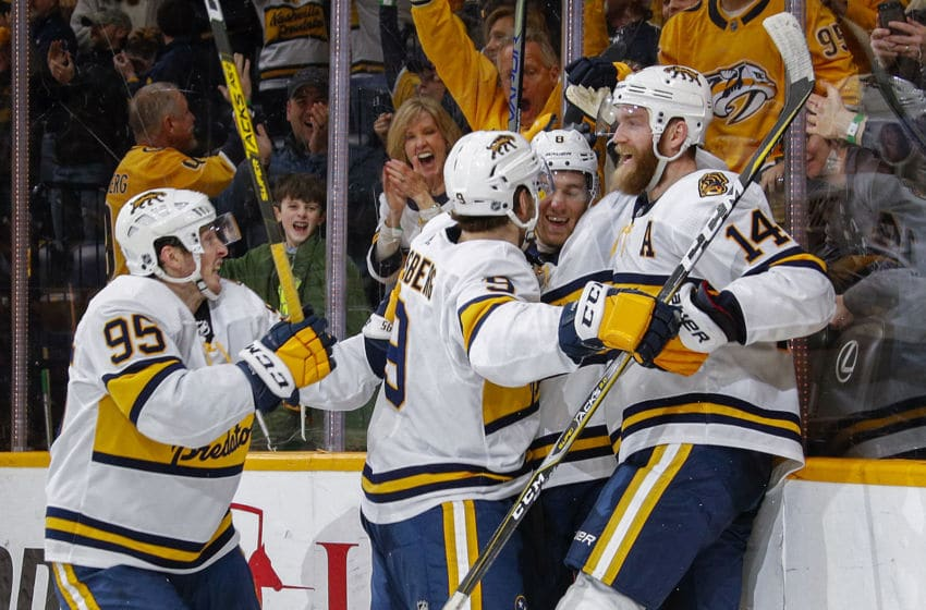 NASHVILLE, TENNESSEE - FEBRUARY 16: Kyle Turris #8 of the Nashville Predators is congratulated by teammates Matt Duchene #95, Filip Forsberg #9 and Mattias Ekholm #14 after scoring the go-ahead goal against the St. Louis Blues during the final two minutes of the third period at Bridgestone Arena on February 16, 2020 in Nashville, Tennessee. (Photo by Frederick Breedon/Getty Images)