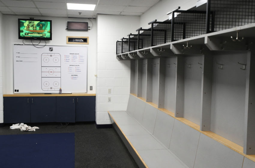 An empty NHL locker room (Photo by Patrick Smith/Getty Images)