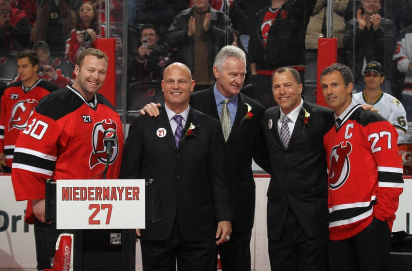 Martin Brodeur and Scott Stevens of the New Jersey Devils honor Scott Niedermayer (Photo by Bruce Bennett/Getty Images)