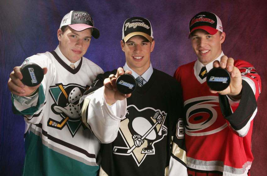 OTTAWA, ONT - JULY 30: The top three draft picks (L-R) Bobby Ryan of the Mighty Ducks of Anaheim, Sidney Crosby of the Pittsburgh Penguins and Jack Johnson of the Carolina Hurricanes pose for a portrait during the 2005 National Hockey League Draft on July 30, 2005 at the Westin Hotel in Ottawa, Canada. (Photo by Brian Bahr/Getty Images for NHL)