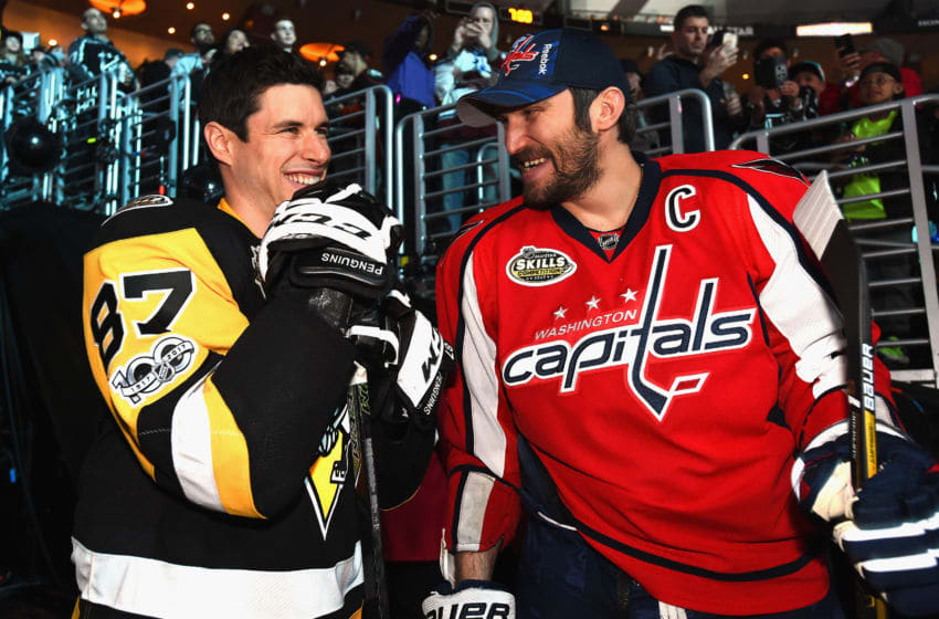 Sidney Crosby #87 of the Pittsburgh Penguins and Alex Ovechkin #8 of the Washington Capitals (Photo by Andrew D. Bernstein/NHLI via Getty Images)