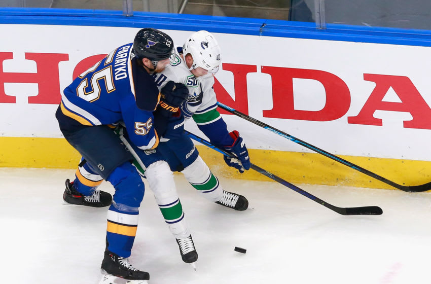 Colton Parayko #55 of the St. Louis Blues and Elias Pettersson #40 of the Vancouver Canucks (Photo by Jeff Vinnick/Getty Images)