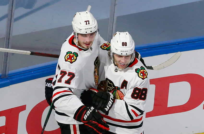Kirby Dach #77 of the Chicago Blackhawks (L). (Photo by Jeff Vinnick/Getty Images)