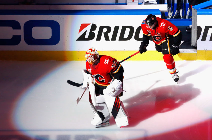 Cam Talbot #39 and Mark Giordano #5 of the Calgary Flames (Photo by Jeff Vinnick/Getty Images)