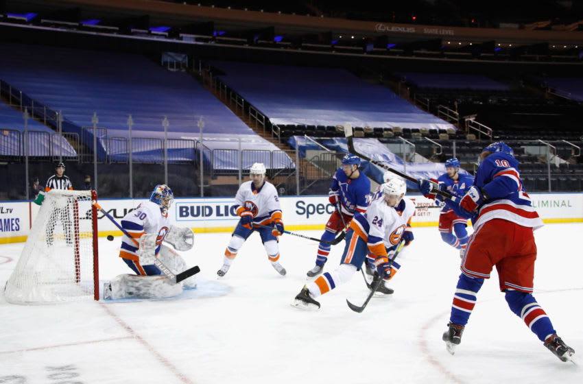 The New York Islanders defend against the New York Rangers. (Photo by Bruce Bennett/Getty Images)