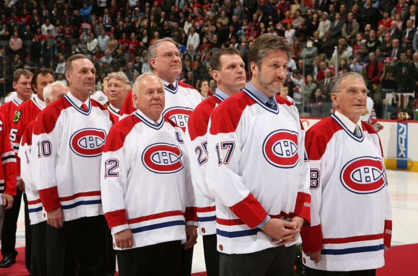 OTTAWA - JANUARY 8: Former Canadiens greats stand on the red carpet during the playing of the national anthems after the Montreal Canadiens' celebration of 82 years of rivalry with the Chicago Blackhawks prior to a game between the two teams at the Bell Centre on January 8, 2008 in Montreal, Quebec. From LEFT to RIGHT are: Guy Lafleur, Yvan Cournoyer, Ken Dryden, Vincent Damphousse, Murray Wilson and Marcel Bonin. (Photo by Andre Ringuette/NHLI via Getty Images)