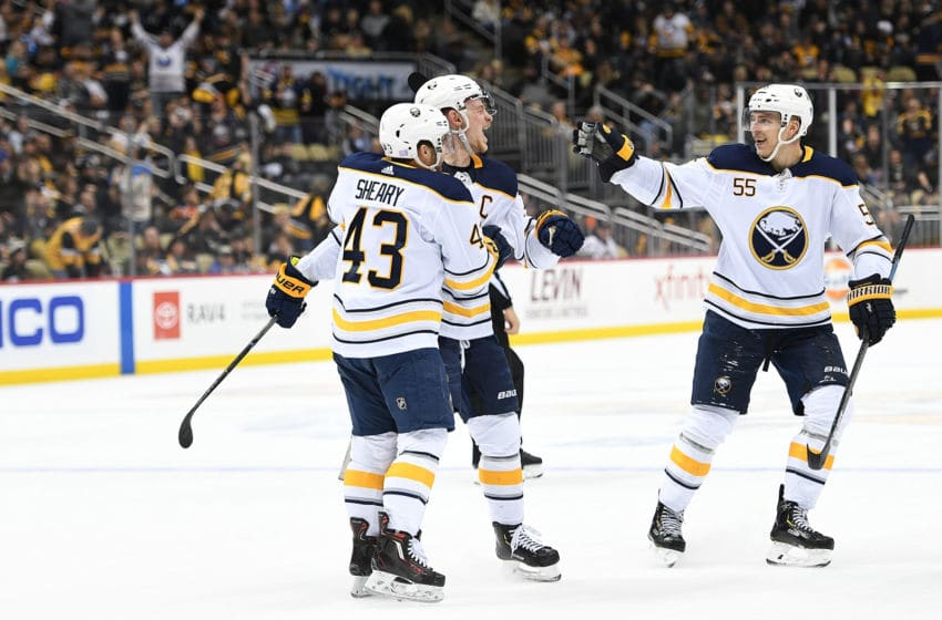PITTSBURGH, PA - NOVEMBER 19: Jack Eichel #9 of the Buffalo Sabres celebrates with Conor Sheary #43 and Rasmus Ristolainen #55 after scoring the game winning goal during overtime to give the Buffalo Sabres a 5-4 win over the Pittsburgh Penguins at PPG PAINTS Arena on November 19, 2018 in Pittsburgh, Pennsylvania. (Photo by Justin Berl/Getty Images)
