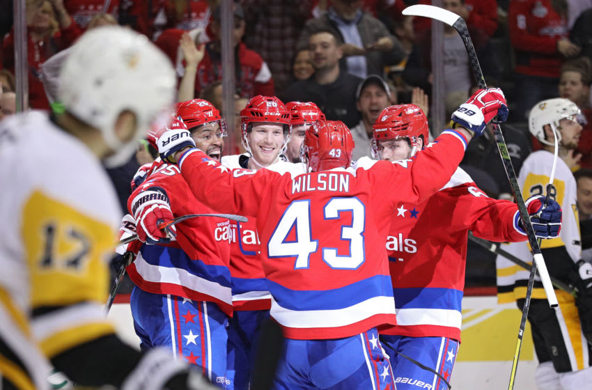 WASHINGTON, DC - DECEMBER 19: Lars Eller #20 of the Washington Capitals celebrates his goal with teammates against the Pittsburgh Penguins during the second period at Capital One Arena on December 19, 2018 in Washington, DC. (Photo by Patrick Smith/Getty Images)