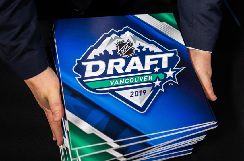 TORONTO, ON - APRIL 10: An NHL official holds the cards during The National Hockey League Draft Lotteryat the CBC Studios on April 10, 2019 in Toronto, Ontario, Canada. (Photo by Kevin Sousa/NHLI via Getty Images)