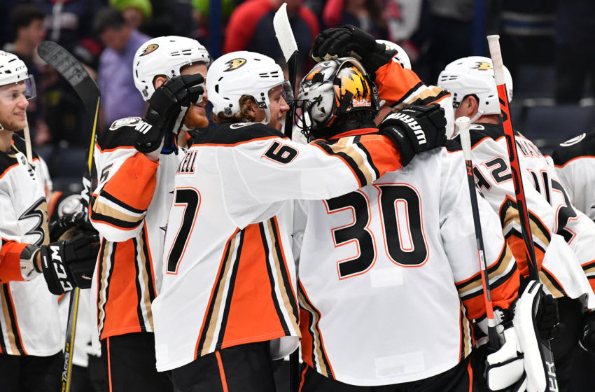 COLUMBUS, OH - OCTOBER 11: Goaltender Ryan Miller #30 of the Anaheim Ducks celebrates with his teammates after defeating the Columbus Blue Jackets 2-1 in a game on October 11, 2019 at Nationwide Arena in Columbus, Ohio. (Photo by Jamie Sabau/NHLI via Getty Images)