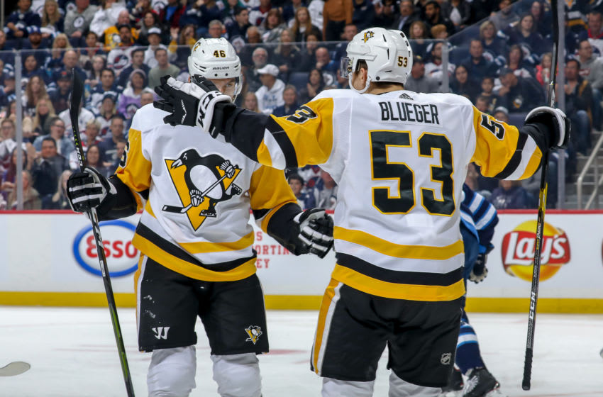 WINNIPEG, MB - OCTOBER 13: Zach Aston-Reese #46 and Teddy Blueger #53 of the Pittsburgh Penguins celebrate a first period goal against the Winnipeg Jets at the Bell MTS Place on October 13, 2019 in Winnipeg, Manitoba, Canada. (Photo by Jonathan Kozub/NHLI via Getty Images)