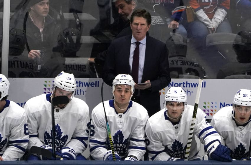 UNIONDALE, NY - NOVEMBER 13: Toronto Maple Leafs Head Coach Mike Babcock looks on from the bench during the first period of the National Hockey League game between the Toronto Maple Leafs and the New York Islanders on November 13, 2019, at the Nassau Veterans Memorial Coliseum in Uniondale, NY. (Photo by Gregory Fisher/Icon Sportswire via Getty Images)