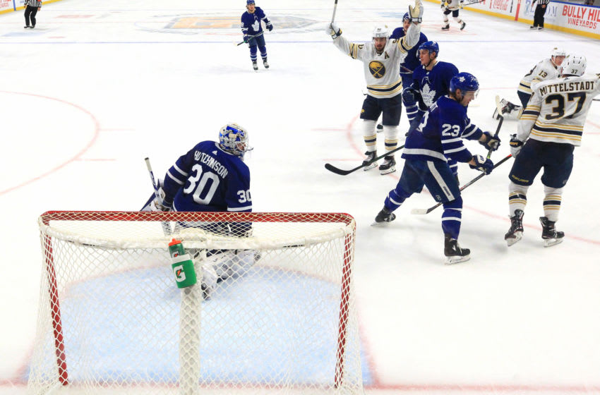 BUFFALO, NY - NOVEMBER 29: Casey Mittelstadt #37 of the Buffalo Sabres scores a goal against Michael Hutchinson #30 of the Toronto Maple Leafs during the second period of an NHL game on November 29, 2019 at KeyBank Center in Buffalo, New York. (Photo by Bill Wippert/NHLI via Getty Images)