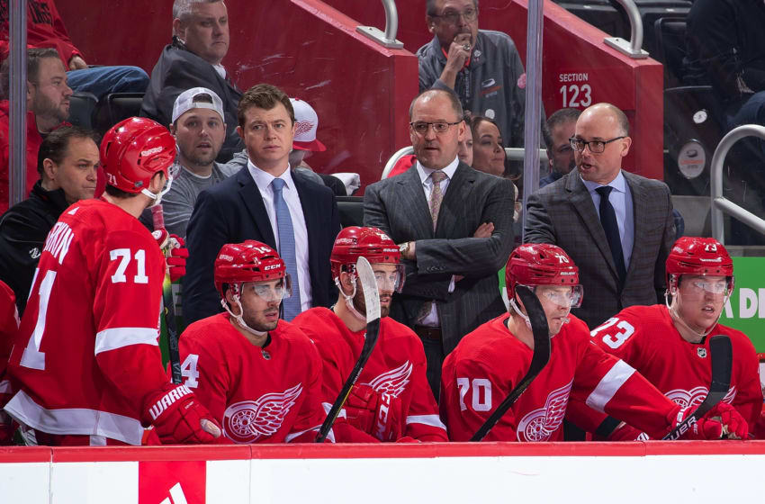 DETROIT, MI - DECEMBER 07: Dylan Larkin #71 of the Detroit Red Wings talks to coaches From L to R Assistant coach Adam Nightingale, Assistant coach Dan Bylsma and Head coach Jeff Blashill of the Detroit Red Wings during an NHL game against the Pittsburgh Penguins at Little Caesars Arena on December 7, 2019 in Detroit, Michigan. The Penguins defeated the Wings 5-3. (Photo by Dave Reginek/NHLI via Getty Images)