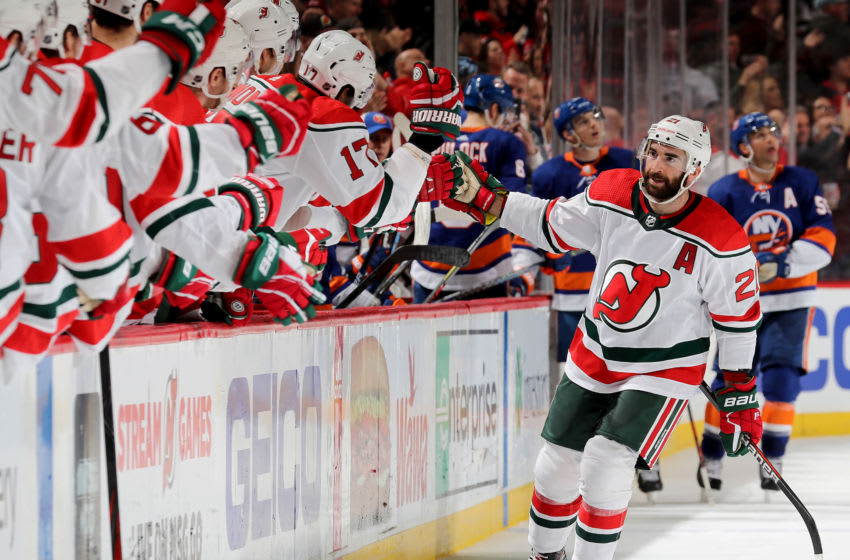 NEWARK, NEW JERSEY - JANUARY 07: Kyle Palmieri #21 of the New Jersey Devils celebrates his goal with teammates on the bench in the third period against the New York Islanders at Prudential Center on January 07, 2020 in Newark, New Jersey.The New York Islanders defeated the New Jersey Devils 4-3 in overtime. (Photo by Elsa/Getty Images)