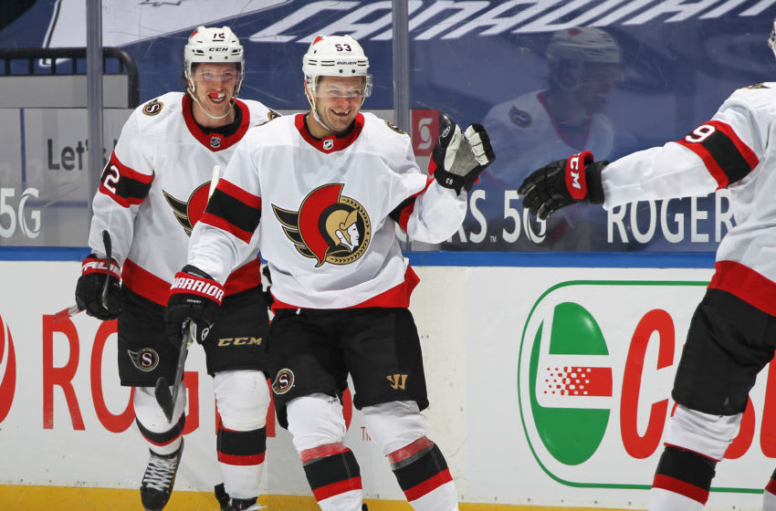 TORONTO, ON - FEBRUARY 15: Evgenii Dadonov #63 of the Ottawa Senators celebrates his game-winning goal in overtime against the Toronto Maple Leafs in an NHL game at Scotiabank Arena on February 15, 2021 in Toronto, Ontario, Canada. The Senators defeated the Maple Leafs 6-5 in overtime. (Photo by Claus Andersen/Getty Images)