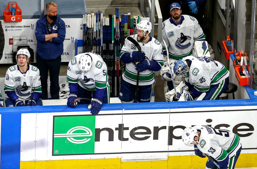 EDMONTON, ALBERTA - SEPTEMBER 04: The Vancouver Canucks react to their deficit against the Vegas Golden Knights late in the third period in Game Seven of the Western Conference Second Round during the 2020 NHL Stanley Cup Playoffs at Rogers Place on September 04, 2020 in Edmonton, Alberta, Canada. (Photo by Bruce Bennett/Getty Images)