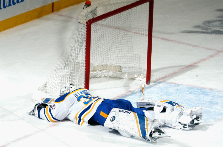 NEWARK, NEW JERSEY - FEBRUARY 23: Linus Ullmark #35 of the Buffalo Sabres lies on the ice after losing a shutout bid in the closing minute of the game against the New Jersey Devils at Prudential Center on February 23, 2021 in Newark, New Jersey. (Photo by Bruce Bennett/Getty Images)