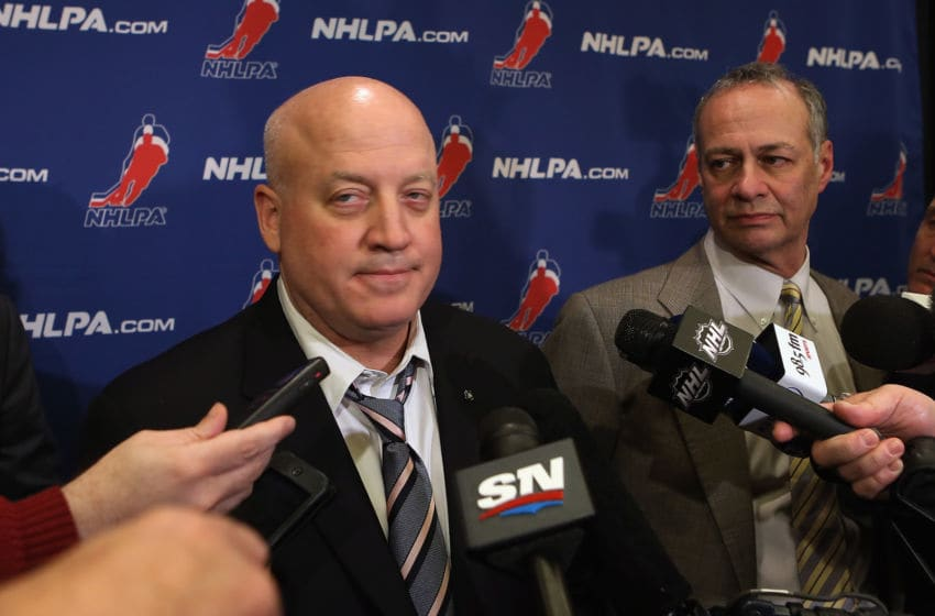 Bill Daly, Deputy Commissioner of the NHL and Steve Fehr of the NHL Players Association (Photo by Bruce Bennett/Getty Images)