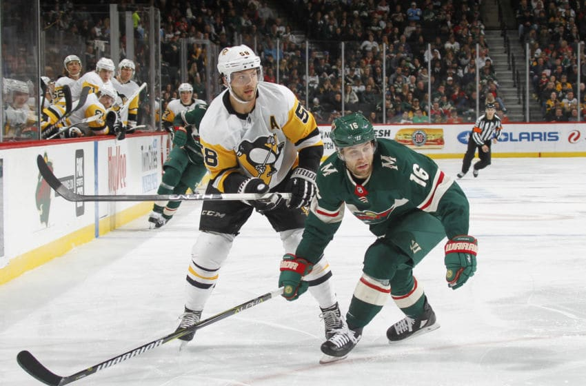 ST. PAUL, MN - OCTOBER 28: Jason Zucker #16 of the Minnesota Wild defends Kris Letang #58 of the Pittsburgh Penguins during the game at the Xcel Energy Center on October 28, 2017 in St. Paul, Minnesota. (Photo by Bruce Kluckhohn/NHLI via Getty Images)