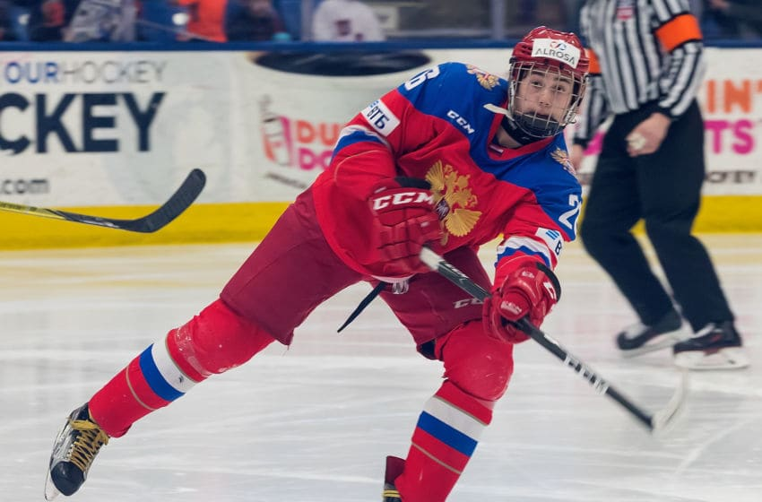 PLYMOUTH, MI - FEBRUARY 16: Alexander Romanov #26 of the Russian Nationals passes the puck against the USA Nationals during the 2018 Under-18 Five Nations Tournament game at USA Hockey Arena on February 16, 2018 in Plymouth, Michigan. USA defeated Russia 5-4. (Photo by Dave Reginek/Getty Images)*** Local Caption *** Alexander Romanov