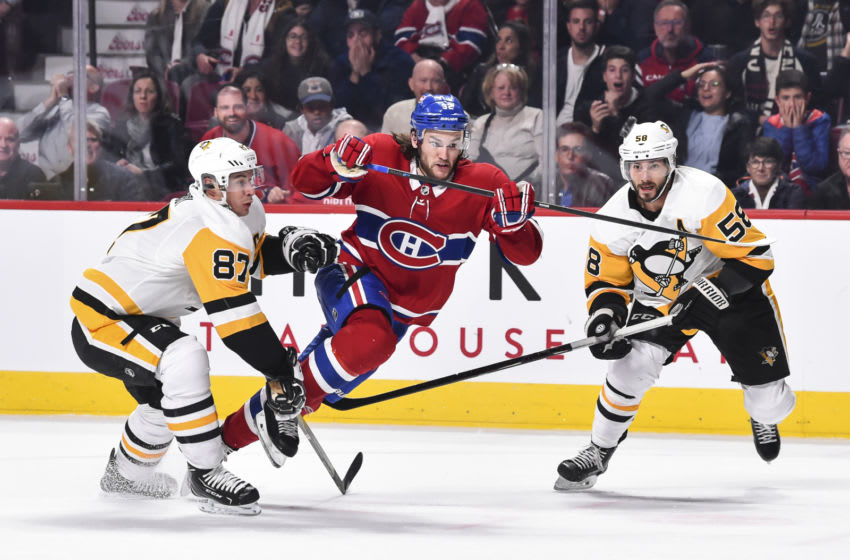 MONTREAL, QC - OCTOBER 13: Jonathan Drouin #92 of the Montreal Canadiens tries to skate past Sidney Crosby #87 and Kris Letang #58 of the Pittsburgh Penguins during the NHL game at the Bell Centre on October 13, 2018 in Montreal, Quebec, Canada. The Montreal Canadiens defeated the Pittsburgh Penguins 4-3 in a shootout. (Photo by Minas Panagiotakis/Getty Images)
