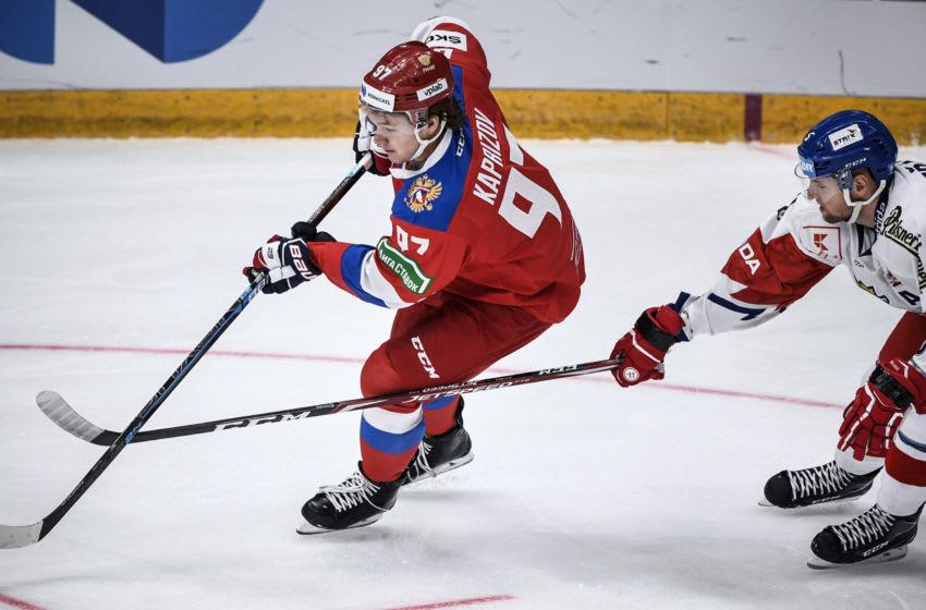 Russian forward Kirill Kaprizov (L) (Photo by ALEXANDER NEMENOV/AFP via Getty Images)