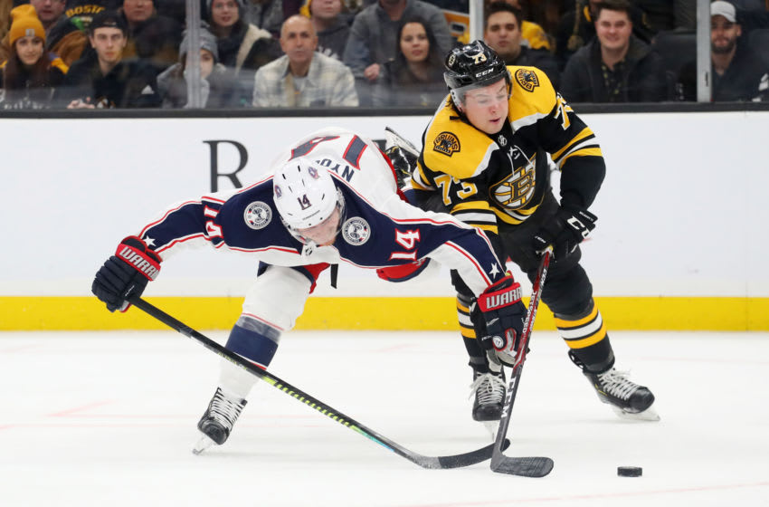 Charlie McAvoy #73 of the Boston Bruins and Gustav Nyquist #14 of the Columbus Blue Jackets (Photo by Maddie Meyer/Getty Images)