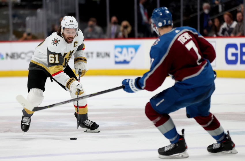 DENVER, COLORADO - JUNE 02: Mark Stone #61 of the Vegas Golden Knights advances the puck against Devon Toews #7 of the Colorado Avalanche during the third period in Game Two of the Second Round of the 2021 Stanley Cup Playoffs at Ball Arena on June 2, 2021 in Denver, Colorado. (Photo by Matthew Stockman/Getty Images)