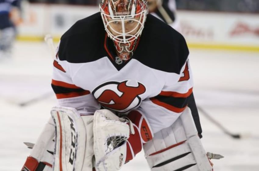 Jan 23, 2016; Winnipeg, Manitoba, CAN; New Jersey Devils goalie Cory Schneider (35) warms up prior to the game against the Winnipeg Jets at MTS Centre. Mandatory Credit: Bruce Fedyck-USA TODAY Sports
