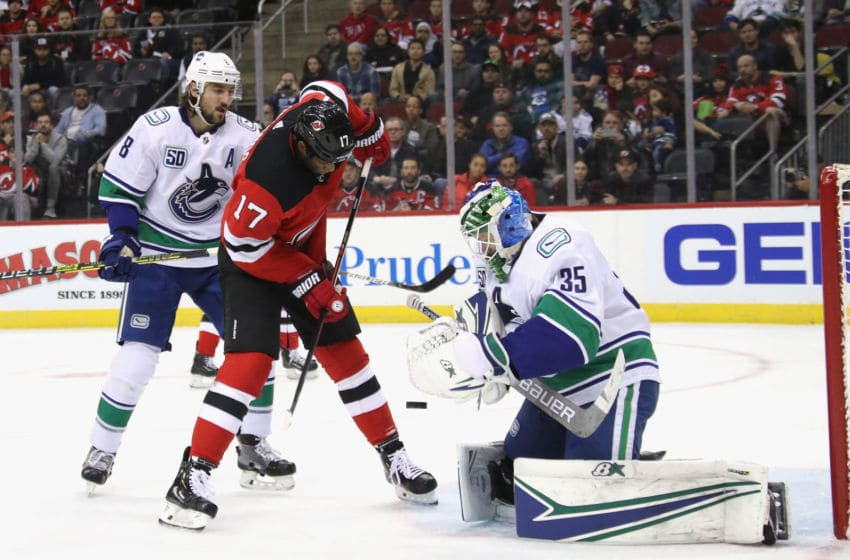 NEWARK, NEW JERSEY - OCTOBER 19: Thatcher Demko #35 of the Vancouver Canucks makes the second period save on Wayne Simmonds #17 of the New Jersey Devils at the Prudential Center on October 19, 2019 in Newark, New Jersey. (Photo by Bruce Bennett/Getty Images)