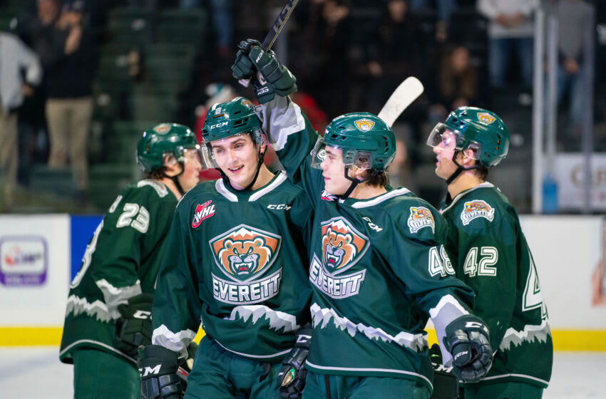 Everett Silvertips defensemen Ronan Seeley #8 and Olen Zellweger #48 celebrate a victory after a game between the Tri-City Americans and the Everett Silvertips at Angel of the Winds Arena on December 18, 2019 in Everett, Washington. (Photo by Christopher Mast/Getty Images)