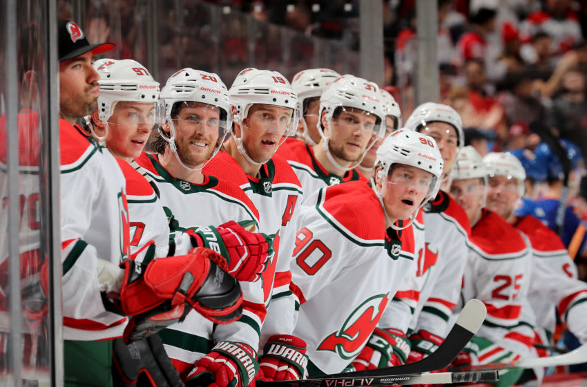 NEWARK, NEW JERSEY - JANUARY 07: Blake Coleman #20 of the New Jersey Devils and the rest of the bench smile after teammate Nico Hischier scored in the second period against the New York Islanders at Prudential Center on January 07, 2020 in Newark, New Jersey. (Photo by Elsa/Getty Images)
