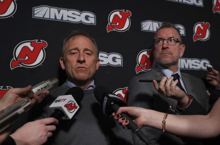 NEWARK, NEW JERSEY - JANUARY 12: New Jersey Devils owner Joshua Harris (L) answers questions from the media after announcing that Tom Fitzgerald (R) has taken over general manager duties prior to a game against the Tampa Bay Lightning at Prudential Center on January 12, 2020 in Newark, New Jersey. The team relieved former general manager Ray Shero earlier in the day. (Photo by Jim McIsaac/Getty Images)