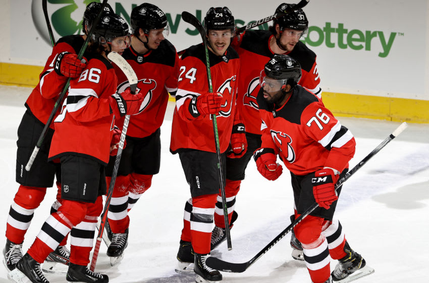 P.K. Subban #76 of the New Jersey Devils is congratulated by teammates Pavel Zacha #37,Ty Smith #24,Jesper Bratt #63 and Jack Hughes #86 after Subban scored in the third period against the Buffalo Sabres at Prudential Center on February 20, 2021 in Newark, New Jersey.The Buffalo Sabres defeated the New Jersey Devils 3-2. (Photo by Elsa/Getty Images)