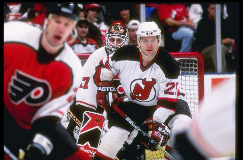 25 Mar 1997: Right wing Valieri Zelepukin of the New Jersey Devils and goaltender Ron Hextall of the Philadelphia Flyers watch the action at Continential Airlines Arena in East Rutherford, New Jersey. The Flyers won the game 4-3. Mandatory Credit: Rick Stewart /Allsport