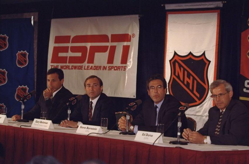 NHL Commissioner Gary Bettman with Roger Iger of ABC and Steve Bornstein of ESPN: (Al Bello /Allsport)
