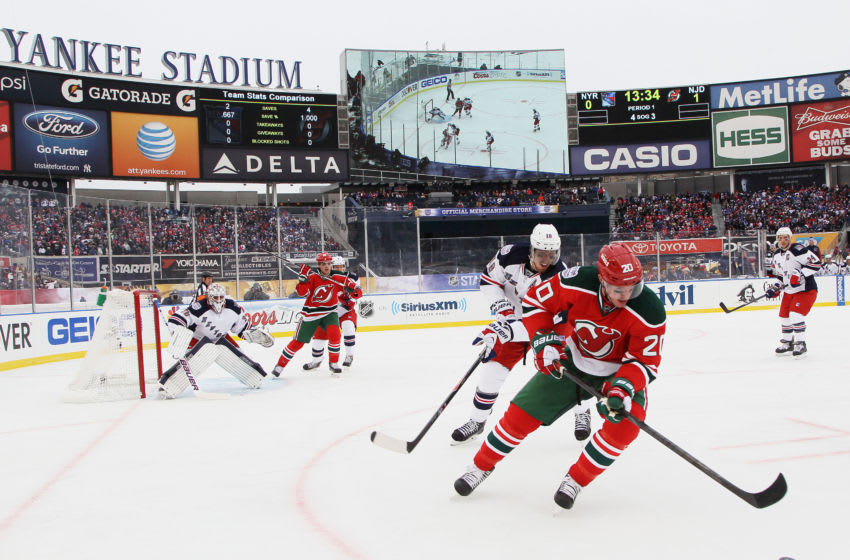 NEW YORK, NY - JANUARY 26: (EDITORIAL USE ONLY) Ryan Carter #20 of the New Jersey Devils controls the puck against the New York Rangers during the 2014 Coors Light NHL Stadium Series at Yankee Stadium on January 26, 2014 in the Bronx borough of New York City. (Photo by Bruce Bennett/Getty Images)