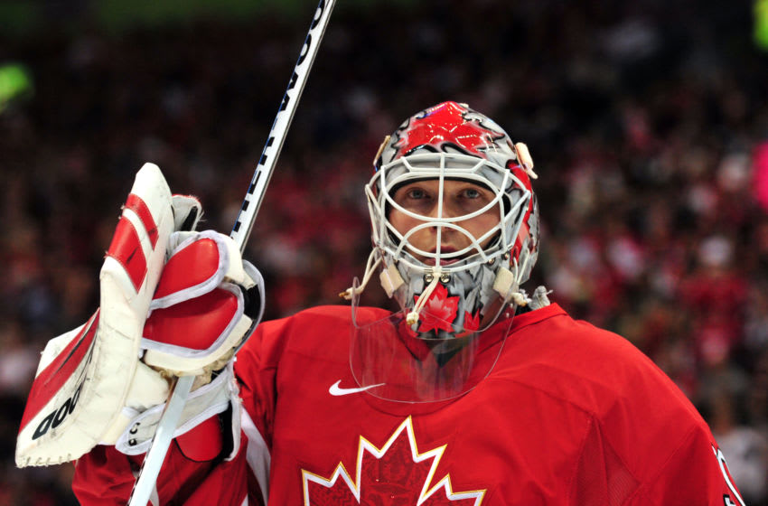 Canada's goalkeeper Martin Brodeur looks up after missing the puck given the USA team their first goal during the Men's preliminary Ice Hockey match Canada against USA at the XXI Winter Olympic games in Vancouver's Canada Hockey Place on February 21, 2010. AFP PHOTO / LUIS ACOSTA (Photo credit should read LUIS ACOSTA/AFP via Getty Images)