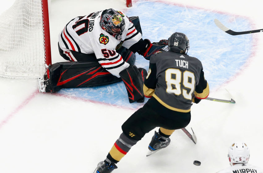 EDMONTON, ALBERTA - AUGUST 13: Alex Tuch #89 of the Vegas Golden Knights is poke checked by Corey Crawford #50 of the Chicago Blackhawks during the third period in Game Two of the Western Conference First Round during the 2020 NHL Stanley Cup Playoffs at Rogers Place on August 13, 2020 in Edmonton, Alberta, Canada. (Photo by Jeff Vinnick/Getty Images)