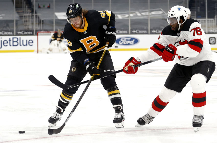 BOSTON, MASSACHUSETTS - FEBRUARY 18: P.K. Subban #76 of the New Jersey Devils defends David Pastrnak #88 of the Boston Bruins during the first period at TD Garden on February 18, 2021 in Boston, Massachusetts. (Photo by Maddie Meyer/Getty Images)