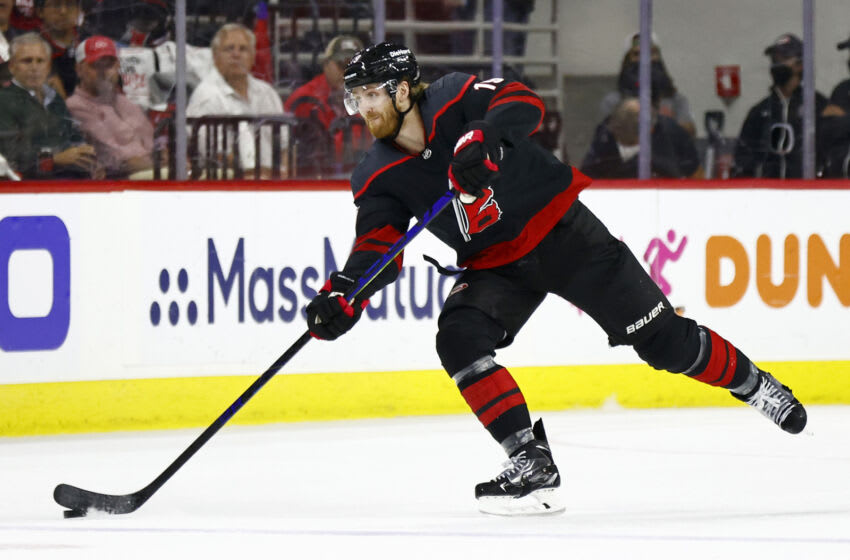 RALEIGH, NORTH CAROLINA - JUNE 08: Dougie Hamilton #19 of the Carolina Hurricanes skates with the puck during the first period in Game Five of the Second Round of the 2021 Stanley Cup Playoffs against the Tampa Bay Lightning at PNC Arena on June 08, 2021 in Raleigh, North Carolina. (Photo by Jared C. Tilton/Getty Images)