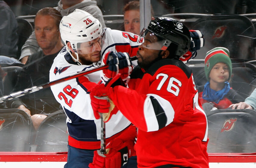 NEWARK, NEW JERSEY - OCTOBER 04: Nic Dowd #26 of the Washington Capitals gets the stick up on P.K. Subban #76 of the New Jersey Devils during the first period in a preseason game at the Prudential Center on October 04, 2021 in Newark, New Jersey. (Photo by Bruce Bennett/Getty Images)