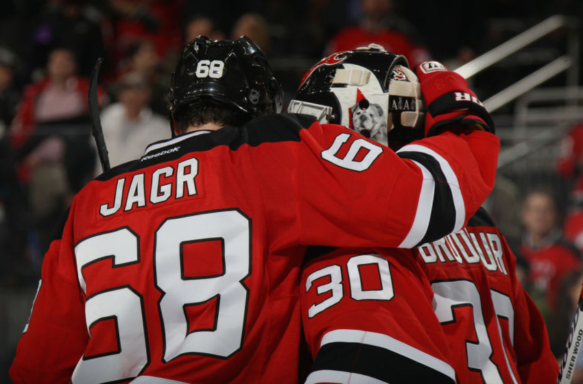 NEWARK, NJ - MARCH 04: Jaromir Jagr #68 embraces Martin Brodeur #30 of the New Jersey Devils foillowing a 4-3 victory over the Detroit Red Wings at the Prudential Center on March 4, 2014 in Newark, New Jersey. (Photo by Bruce Bennett/Getty Images)