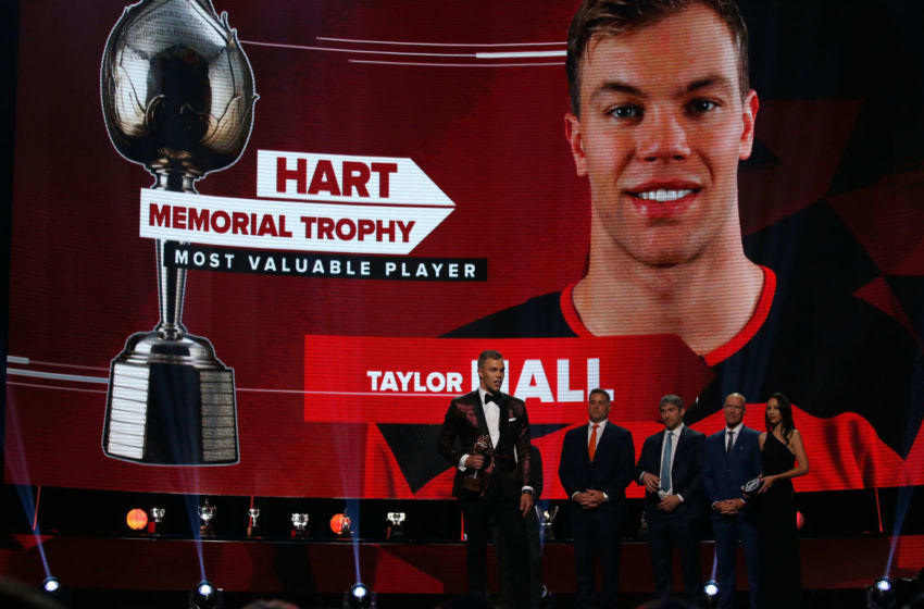 LAS VEGAS, NV - JUNE 20: Taylor Hall of the New Jersey Devils accepts the Hart Trophy given to the most valuable player to his team onstage at the 2018 NHL Awards presented by Hulu at The Joint inside the Hard Rock Hotel & Casino on June 20, 2018 in Las Vegas, Nevada. (Photo by Eliot J. Schechter/NHLI via Getty Images)