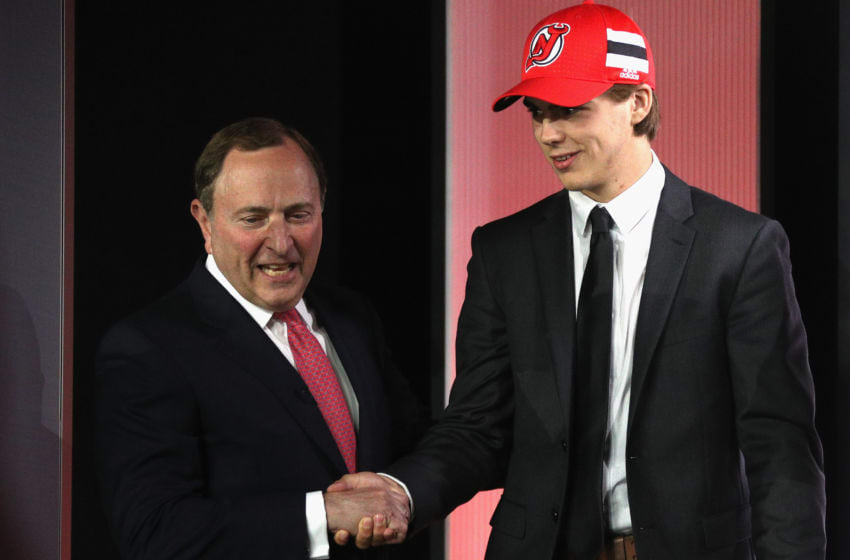CHICAGO, IL - JUNE 23: Nico Hischier, first overall pick of the New Jersey Devils, shakes the hand of NHL Commissioner Gary Bettman onstage during Round One of the 2017 NHL Draft at United Center on June 23, 2017 in Chicago, Illinois. (Photo by Dave Sandford/NHLI via Getty Images)
