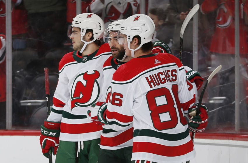 NEWARK, NJ - DECEMBER 20: Kyle Palmieri #21 of the New Jersey Devils celebrates his first period goal with Nico Hischier #13 and Jack Hughes #86 during the game against the Washington Capitals at the Prudential Center on December 20, 2019 in Newark, New Jersey. (Photo by Andy Marlin/NHLI via Getty Images)
